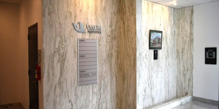 Lobby with granite floors and single piece floor to ceiling marble walls.